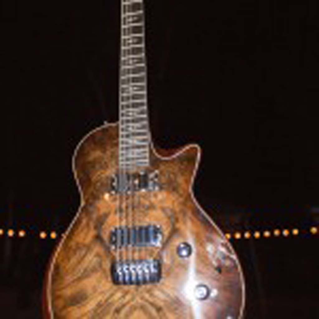 An electric guitar donated by Taylor Guitars will be raffled off in a drawing to be held Oct. 25. Photo by Daniel Knighton