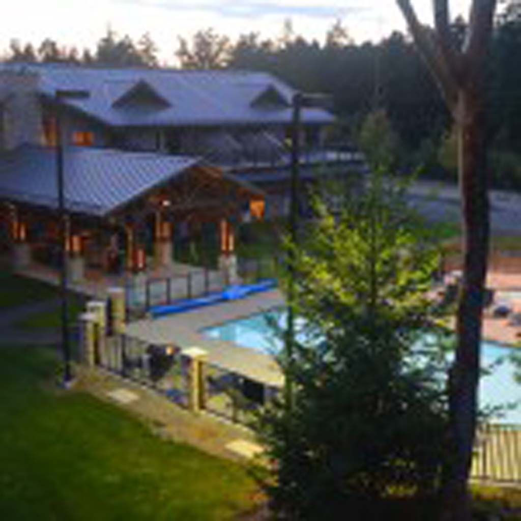 Sunrise Ridge Waterfront Resort is ideally located for a few days or extended stays on the Canadian Riviera on the southeast coast of Vancouver Island, British Columbia. Guests who stay in the high-end, well stocked condos have access to this heated pool and fitness facilities.