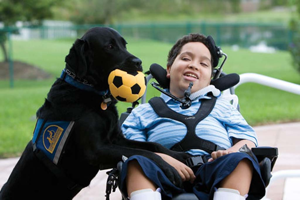 """I used to be the kid in the wheelchair. Now, I'm the kid with the amazing dog,"" said Cory, above with his skilled companion dog Melly. Cory was paired with Melly by the Oceanside-based Canine Companions for Independence. Courtesy photo"
