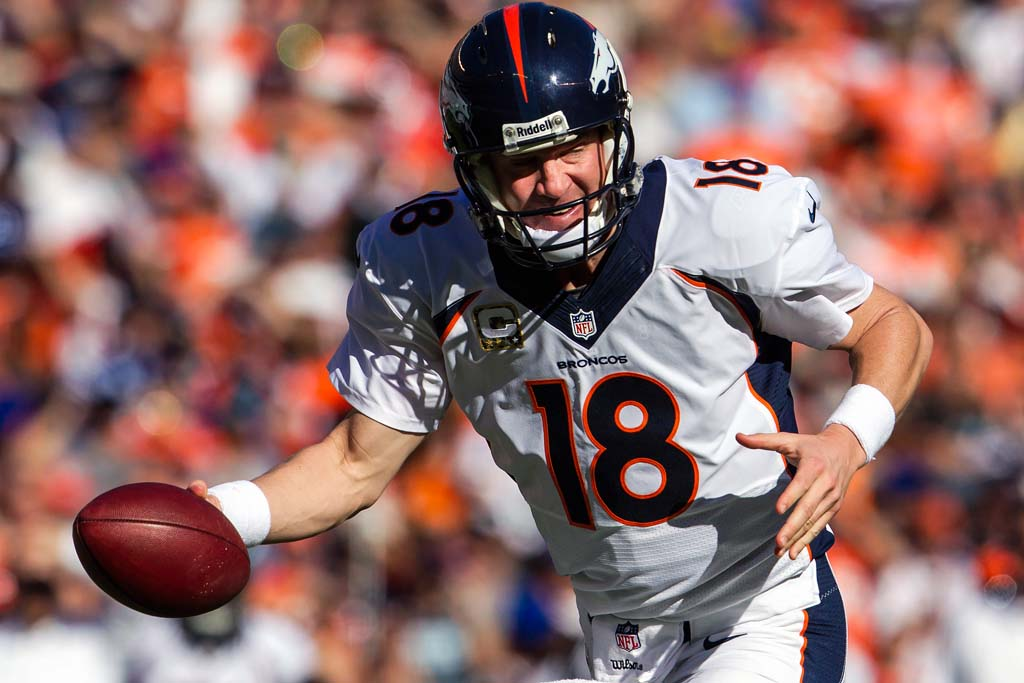Denver Broncos quarterback Peyton Manning fakes a hand off in the 28-20 win over the Chargers at Qualcomm Stadium on Sunday. Photo by Bill Reilly