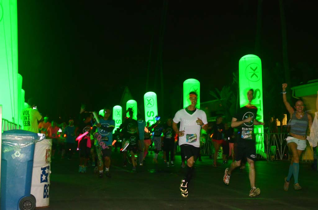 Runners flock to the starting line before the Electric Race begins.