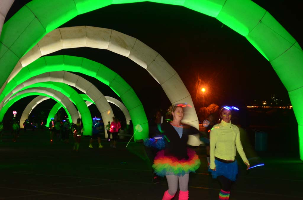 Racers make their way through lighted arches during the race.