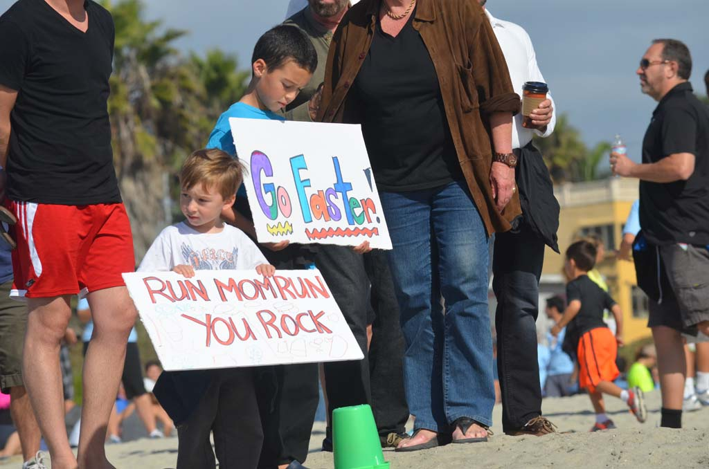 Youngsters wait to cheer on their mom running in the Save the Ocean race.