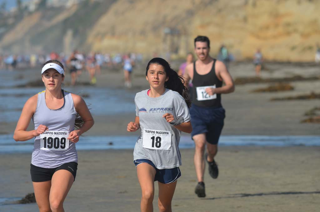 Runners head back towards Moonlight Beach and the finish line.