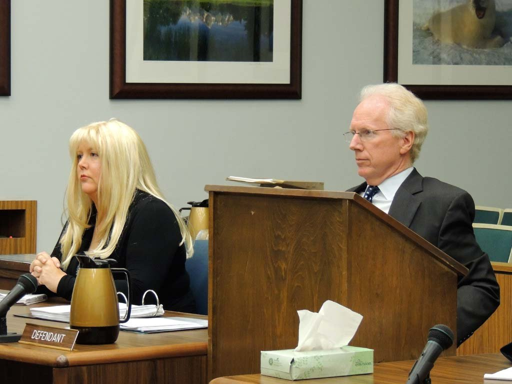 "Former San Diego County District Attorney Paul Pfingst, right, repeatedly called accusations that he improperly altered evidence during the investigation of Jason Harper's murder ""phony"" during a Nov. 22 court hearing. He is representing Julie Harper, left, who is charged with fatally shooting her husband Jason Harper last year. Photo by Rachel Stine"
