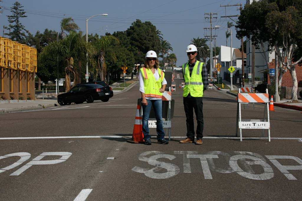 Dara Woods, assistant traffic engineer, and Nathan Mertz, project manager, stand on restriped one-way street. Traffic on Seagaze Drive now heads eastbound only. Photo by Promise Yee