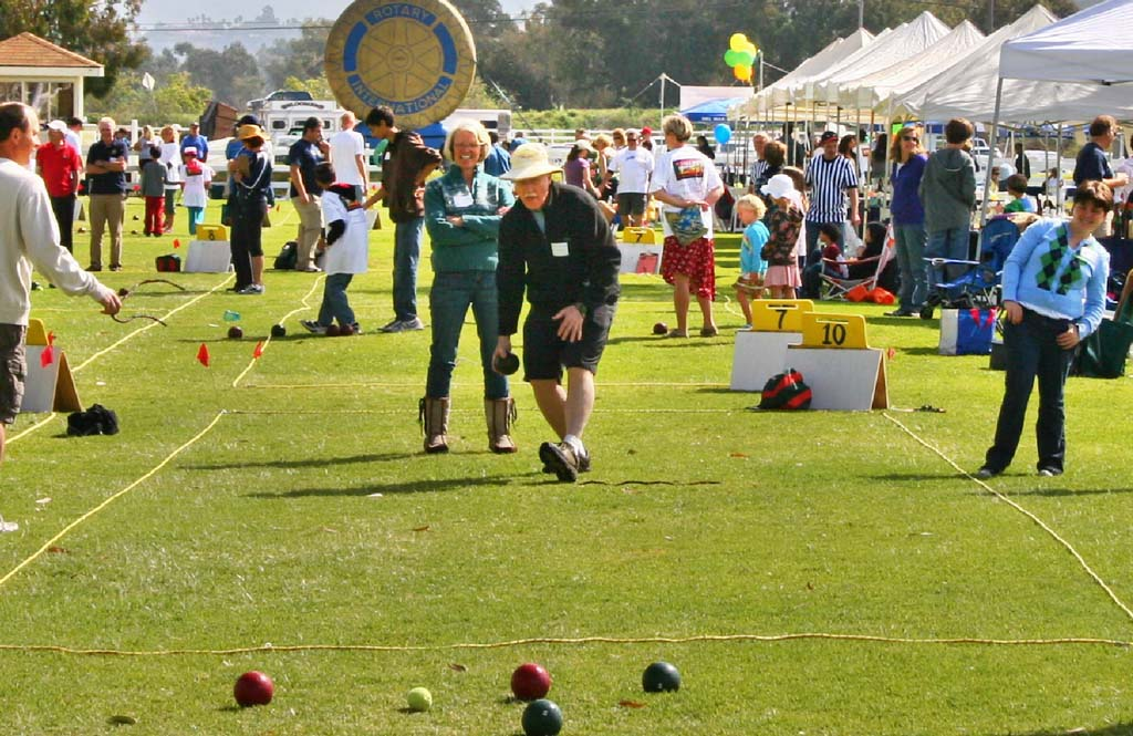Dan Phelan bowls, with Carolyn Phelan and other players and spectators cheering him on. Courtesy photo