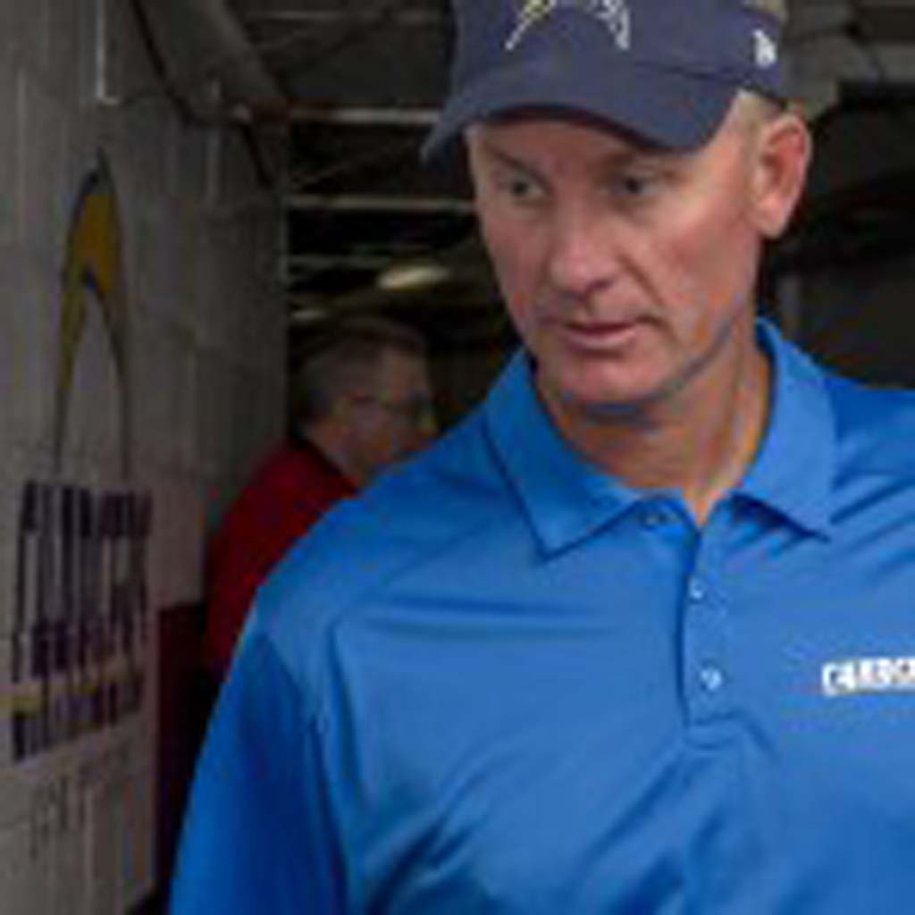 San Diego Chargers Coach Mike McCoy heads out onto the field for pre-game warm ups prior to Sunday's game against the New York Giants at Qualcomm Stadium.