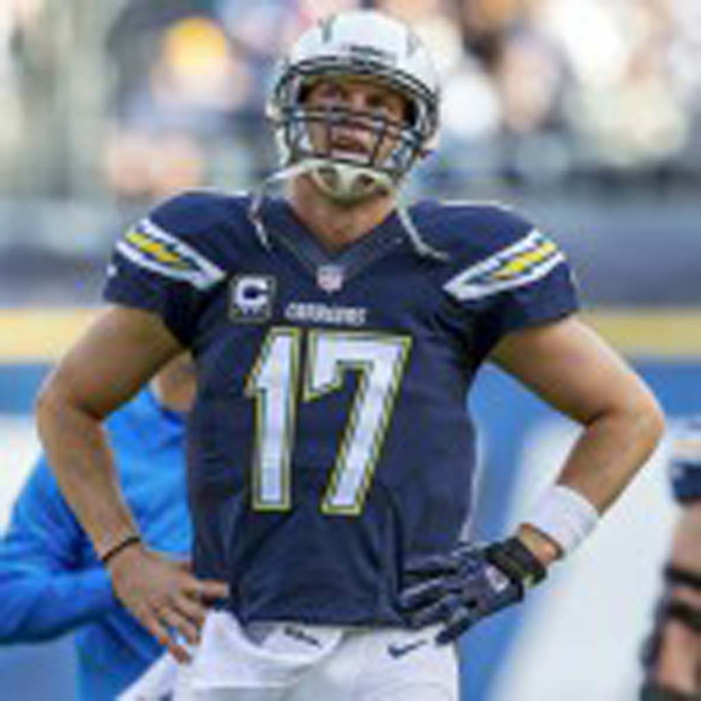 Chargers quarterback Philip Rivers (17) watches a replay of the previous play that ultimately resulted in a touchdown.
