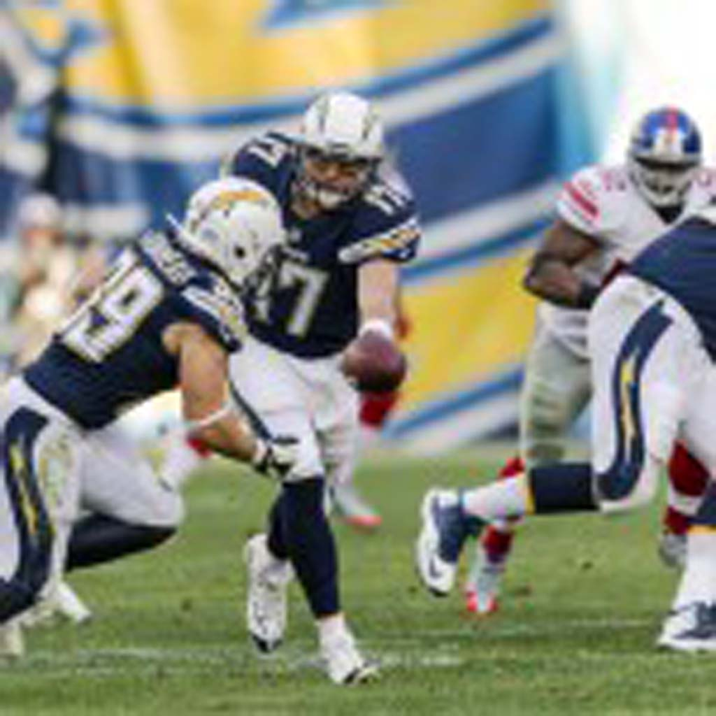 Chargers quarterback Philip Rivers (17) hands the ball off to running back Danny Woodhead (39) during the third quarter. The Chargers went on to beat the Giants 37 - 14 at Qualcomm Stadium.
