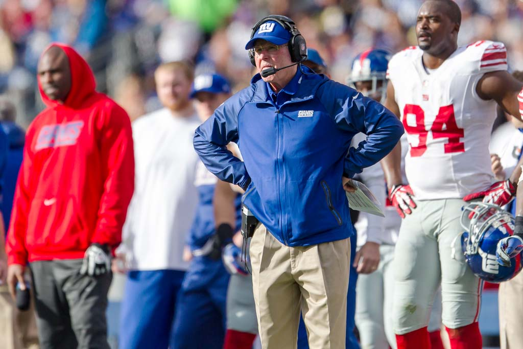 Giants coach Tom Coughlin shows his frustration after the Giants fumble in the third quarter.