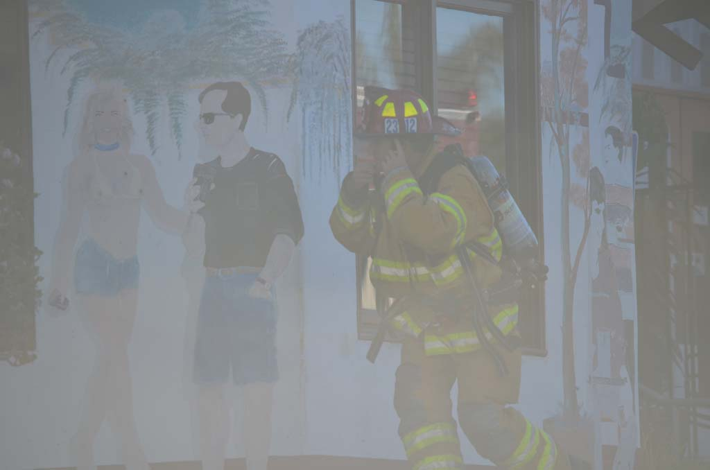 A firefighter walks through smoke to get inside the El Callejon restaurant on Thursday morning. Photo by Tony Cagala