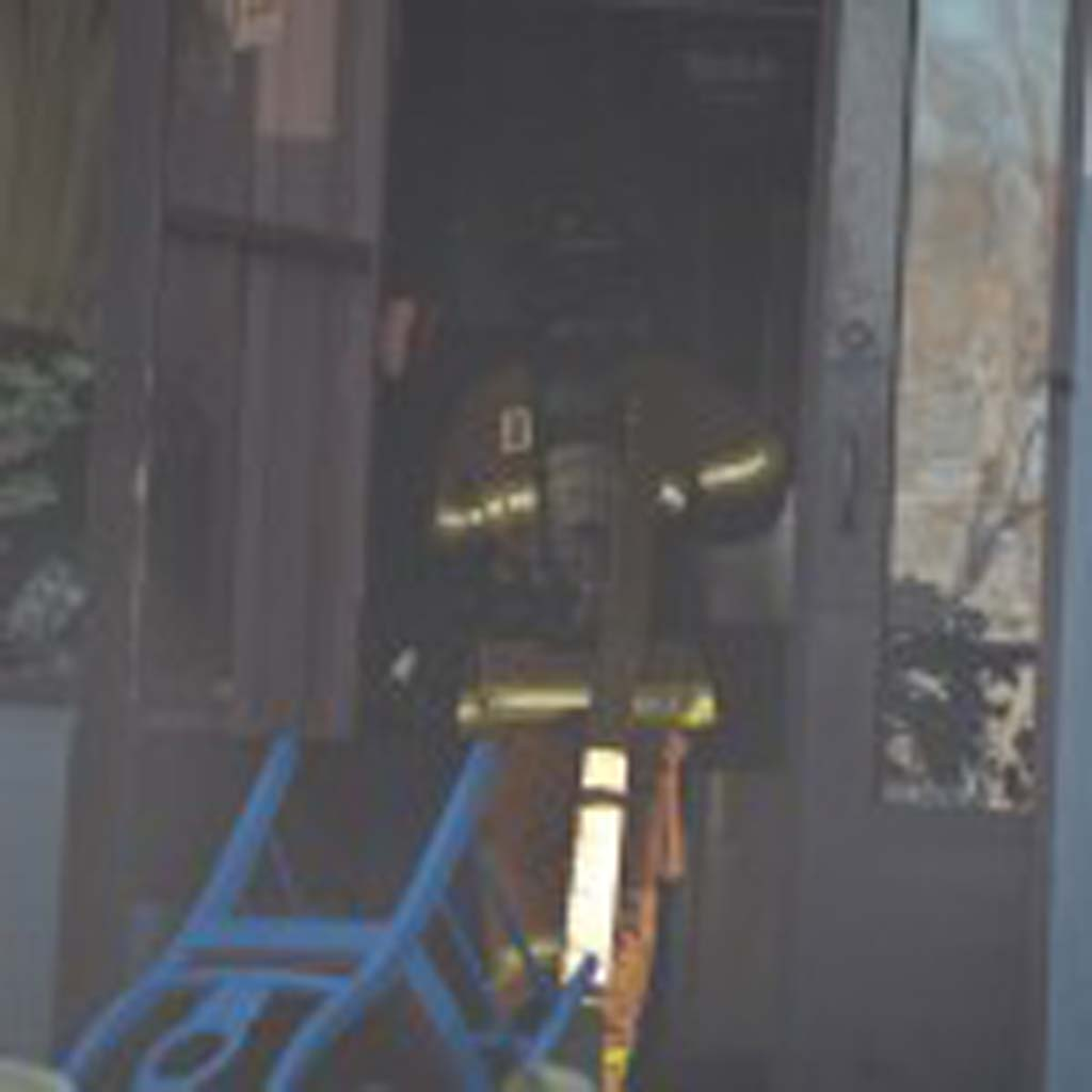 An Encinitas firefighter enters the El Callejon restaurant. Photo by Tony Cagala