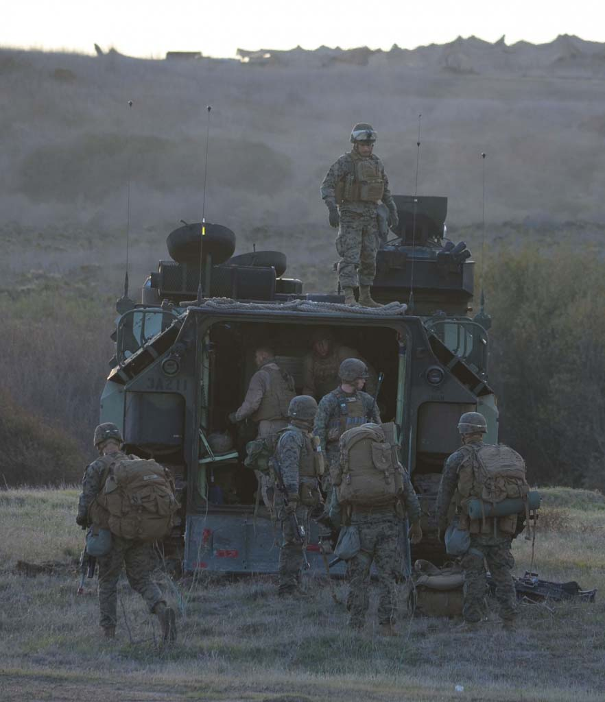 Marines load gear into an amphibious assault vehicle at the conclusion of one portion of the Steel Knight training exercise at Camp Pendleton. Photo by Rachel Stine
