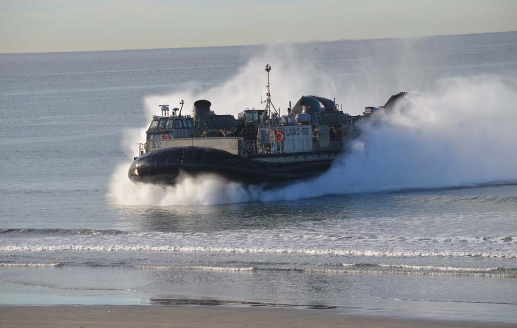 A U.S. Navy landing craft, air cushion, a type of hovercraft, skims the water of Red Beach at Camp Pendleton to deliver heavy equipment during Exercise Steel Knight. Photo by Rachel Stine