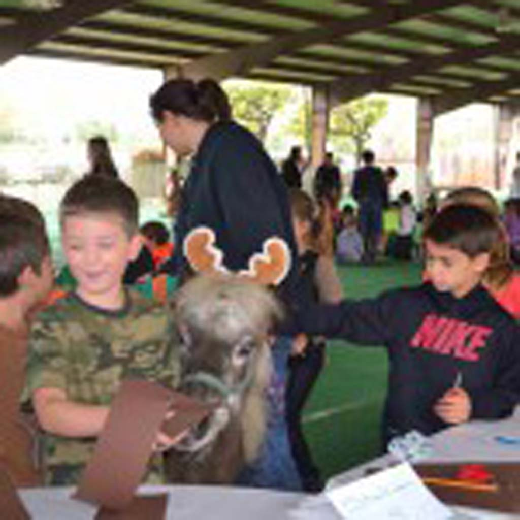 Youngsters from Solana Santa Fe Elementary joined in the spirit of the season at Helen Woodward Animal Center, volunteering to spruce up the grounds and visit with the animals. Courtesy photos