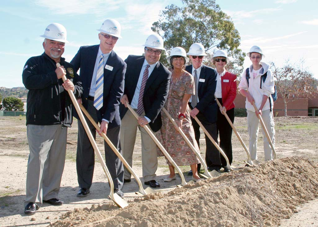 From left California State Assemblyman Rocky Chavez, MiraCosta College Board of Trustee member George McNeil, MiraCosta College Mathematics and Science Dean Carlos Lopez, MiraCosta alumna and Encinitas Mayor Teresa Barth, MiraCosta College Board President David Broad, MiraCosta College Board of Trustee member Jeanne Shannon and MiraCosta College science student Gilad Moskowitz, cheer the groundbreaking for a new science facility at MiraCosta Community College's San Elijo campus. Courtesy photo