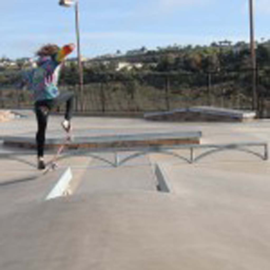 A skateboarder breaks in the new street course early in the morning at the park before crowds covered the course. Photo by Rachel Stine