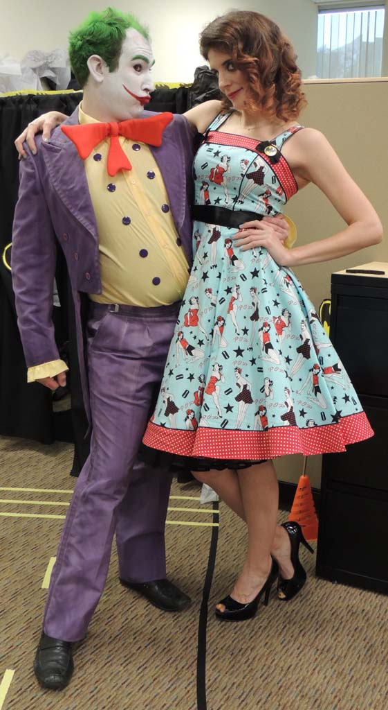 Ryan Lee, as Joker, and Paige Gridack, as the damsel in distress, make amends after Batman saved the day.