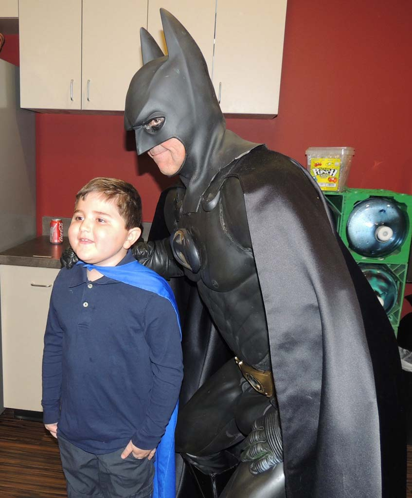 Whisett and Batman smile for adoring fans at Spinal Elements.