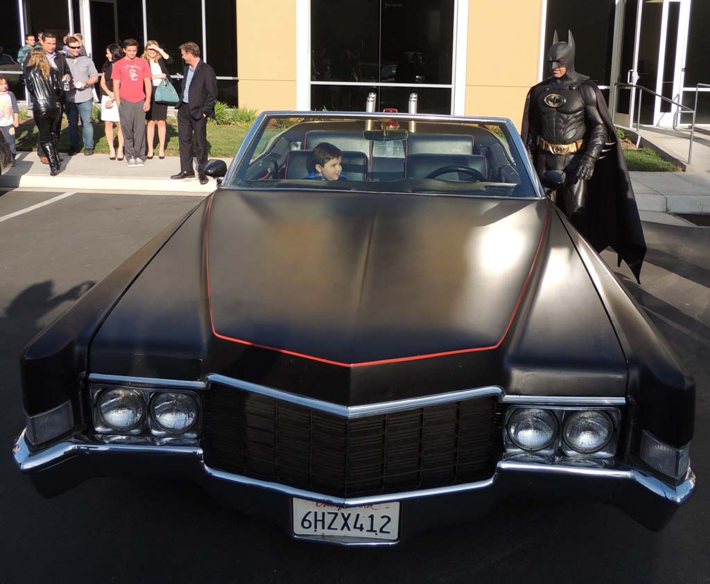Whisett and Batman race to the Batomobile for a victory lap around Spinal Element's parking lot.