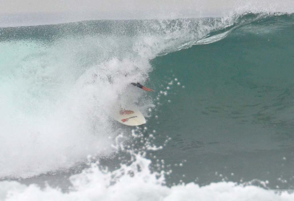 A surfer pulls into a barrel in Encinitas on Tuesday.