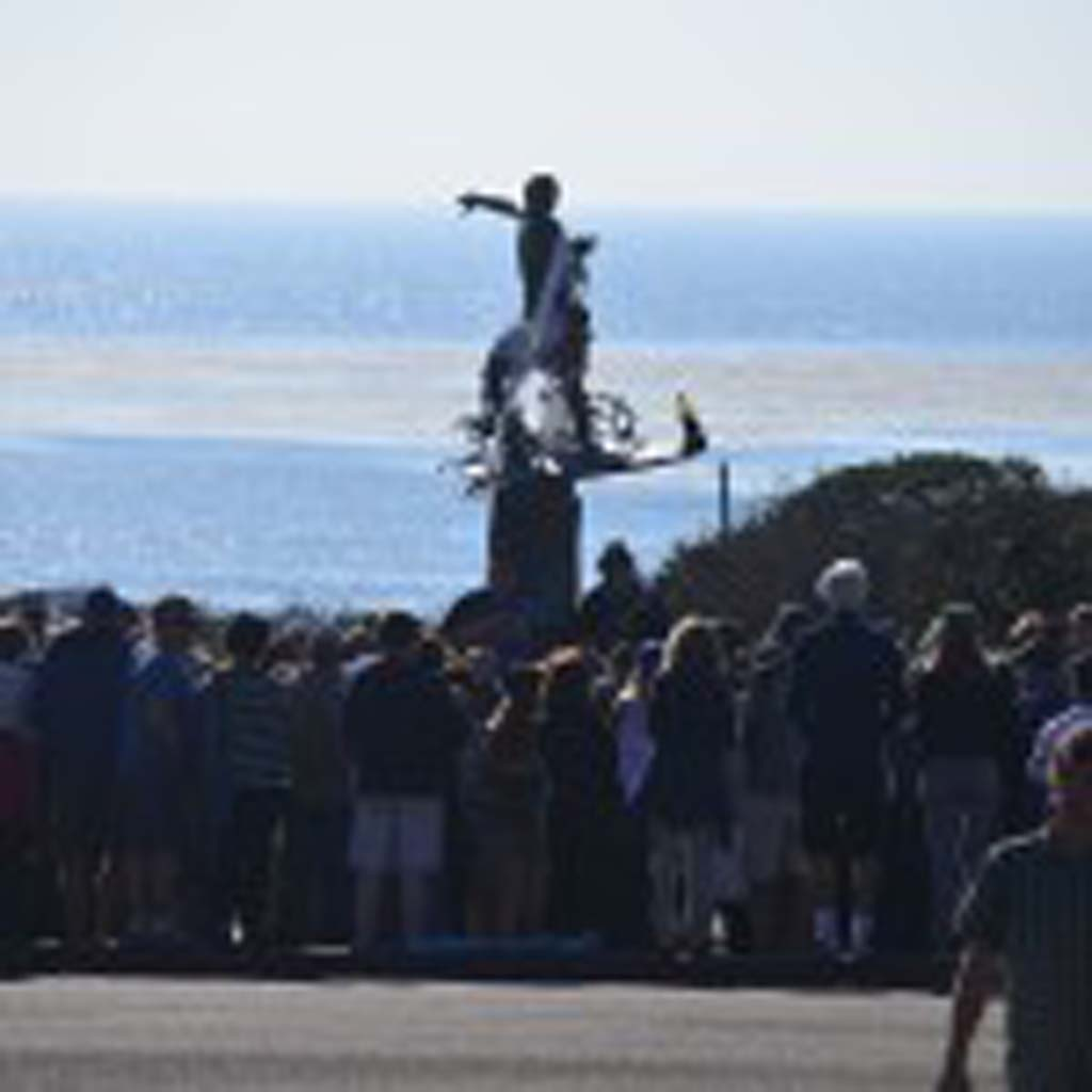 The second annual Splash Jam drew a crowd at the Cardiff Kook statue. Photo by Tony Cagala