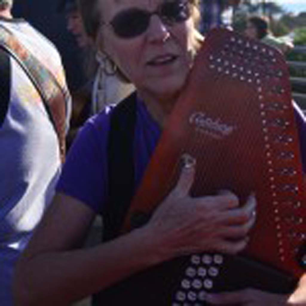 Janice Sharples plays her autoharp. Photo by Tony Cagala
