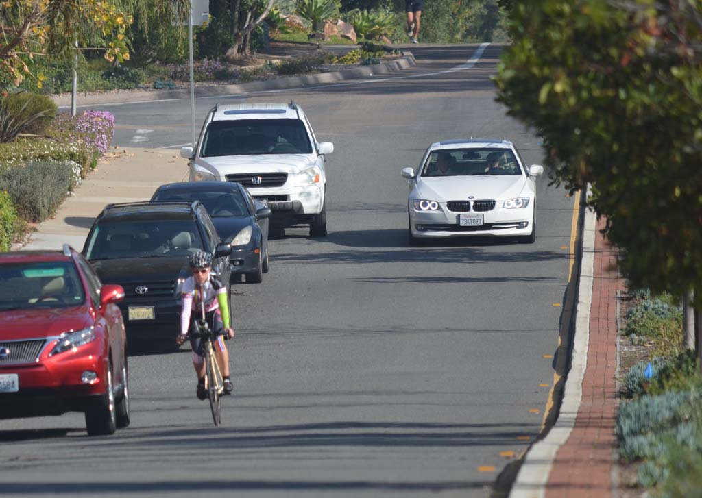 Bicyclists pedal down Paseo Delicias in Rancho Santa Fe where a portion of the street has no bike lane. The cyclists have caught residents' attentions, and the Rancho Santa Fe Association has asked that California Highway Patrol enforce bicycle laws more. Photo by Tony Cagala