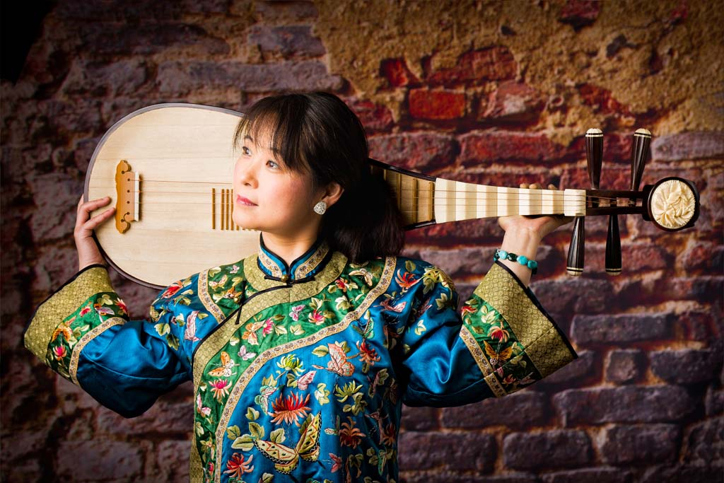 Wu Man will perform on the pipa, an ancient Chinese instrument Feb. 4 at the fundraiser for the Carlsbad Music Festival. Photo by Stephen Kahn