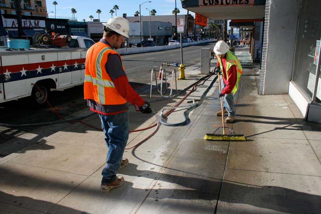 Workers ready sidewalks for jack hammering that will begin Jan. 8. Businesses on Mission Avenue will remain open during construction. Photo by Promise Yee