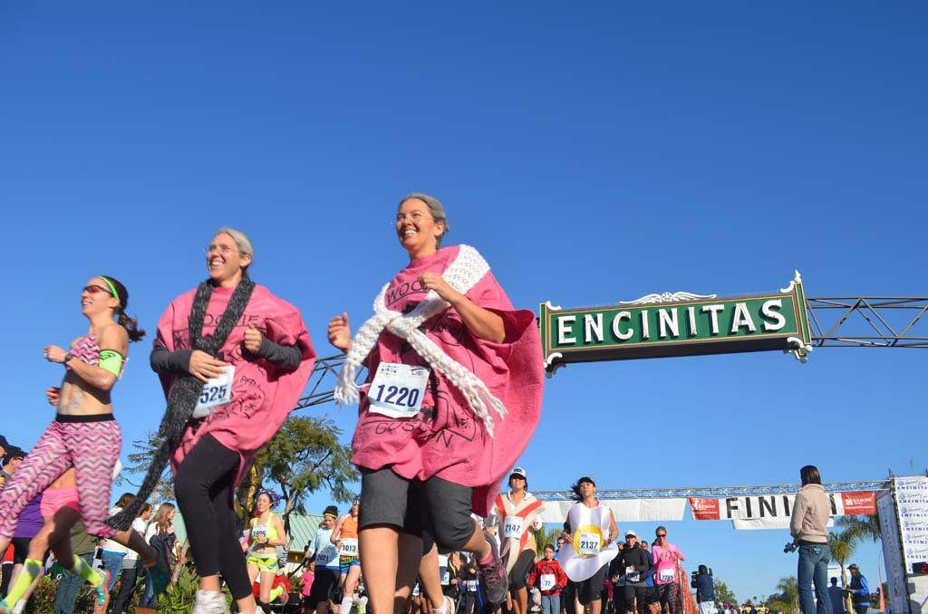 "Calling themselves the ""old farts,"" a group of runners dress up wearing whoopee cushions, take part in the 5k portion of the race. Photo by Tony Cagala"