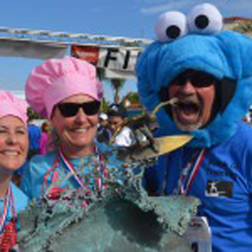 From left: Erin Watson, Tracy Pressnall and Mark Pressnall pose with the Cardiff Kook Run trophy after the race. Photo by Tony Cagala