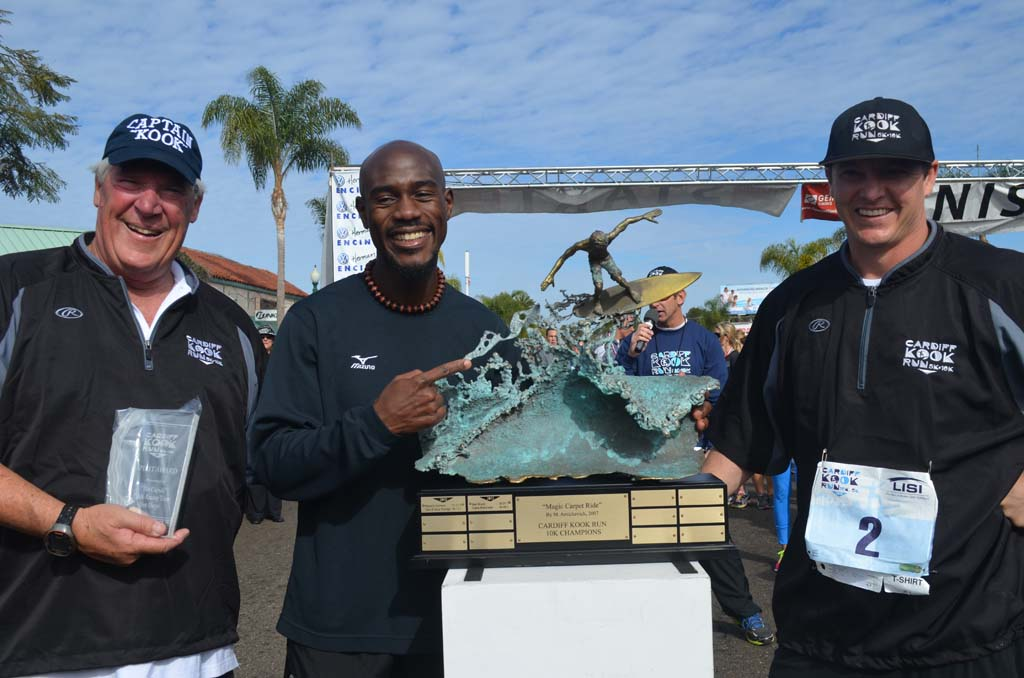 From left Cardiff Kook 10k/5k race co-founder Steve Lebherz, race winner Okwaro Rauro and race co-founder Seth Brewer during the awards ceremony following the race. Photo by Tony Cagala