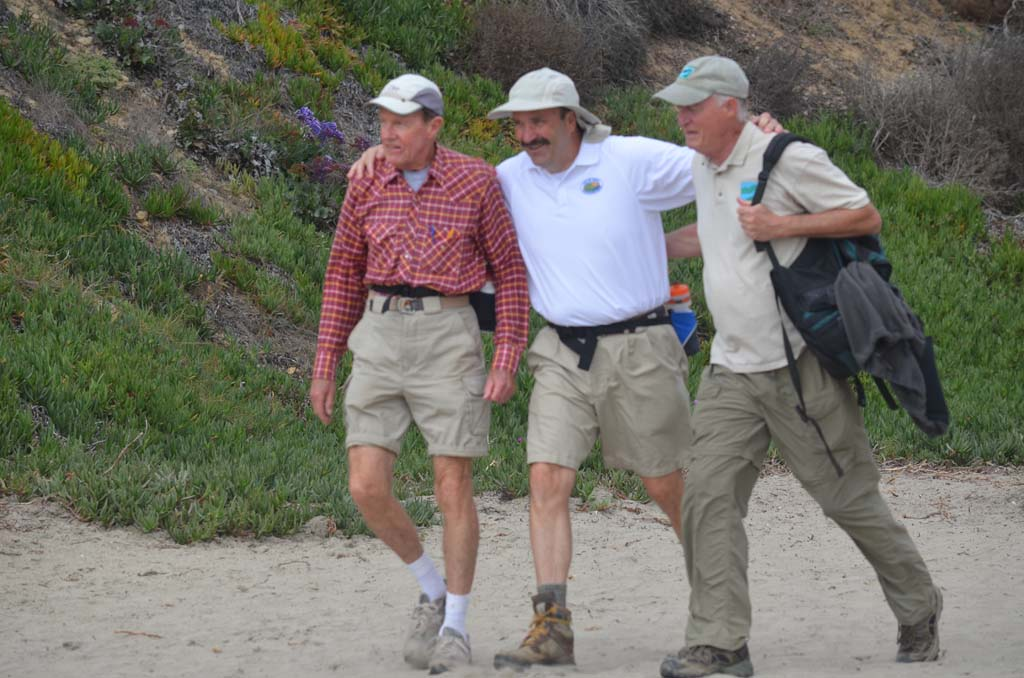 From left: Bill Simmons, Jim Cunningham and Dick Bobertz complete the final six miles of their more than 70-mile trek from the crest of Volcan Mountain to Del Mar's Dog Beach. Photo by Yeshe Salz