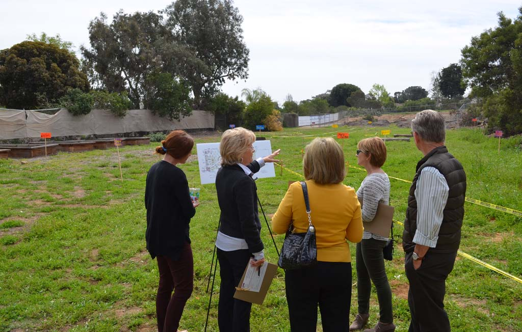 Residents check out plans for a new garden at the Griset Branch of the Boys and Girls Club of San Dieguito. The garden and a new kitchen aim to prevent childhood obesity and encourage healthy lifestyles. Photo by Jared Whitlock