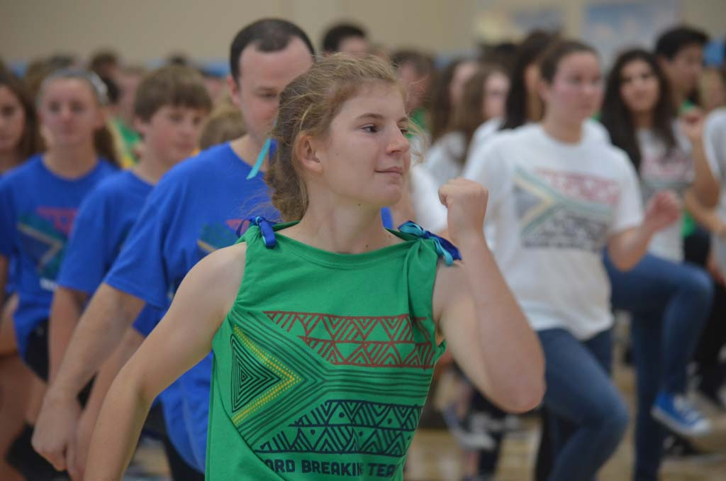 Students from Pacific Ridge School in Carlsbad take part in a record breaking attempt with Guinness World Records for largest African dance. Photo by Tony Cagala