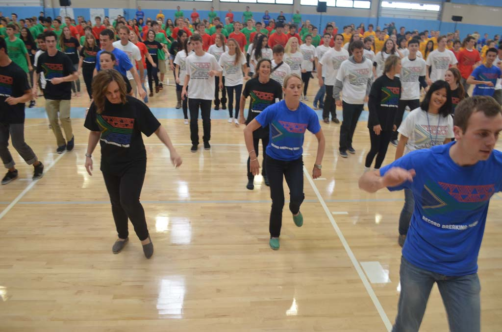 "Students, staff and volunteers earn entry into the Guinness World Records with 504 dancers performing an African dance set to the song, ""Pata Pata."" By Tony Cagala"