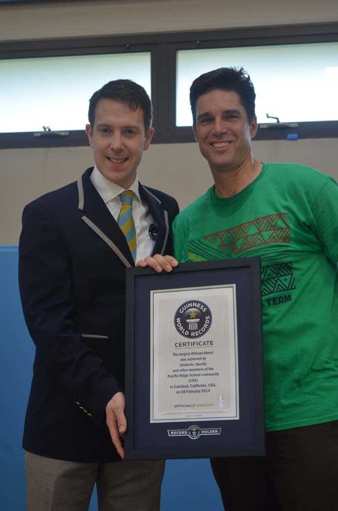 Guinness World Records Adjudicator Philip Robertson, left, presents a certificate to Dr. Bob Ogle, head of Pacific Ridge School on Feb. 28. Photo by Tony Cagala