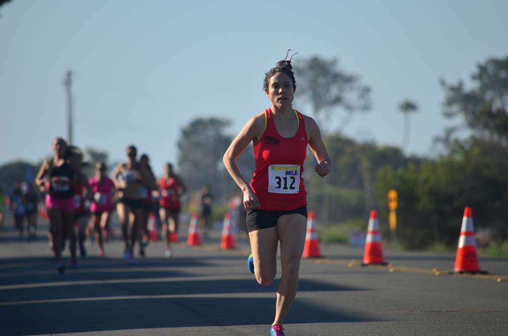 The Encinitas Mile, the inaugural event co-founded by North County runners Mark Sarno and Daniel Seidel, saw several heats of runners head down a portion of Vulcan Avenue and back again. Photo by Tony Cagala