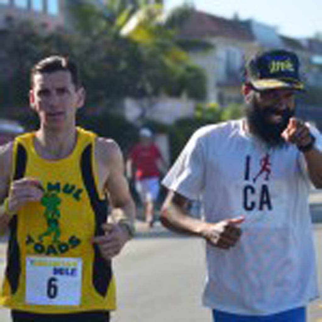 The Encinitas Mile men's elite race winner Sergio Garcia, right, winds down after the race with fellow runner Tim Gore. Photo by Tony Cagala