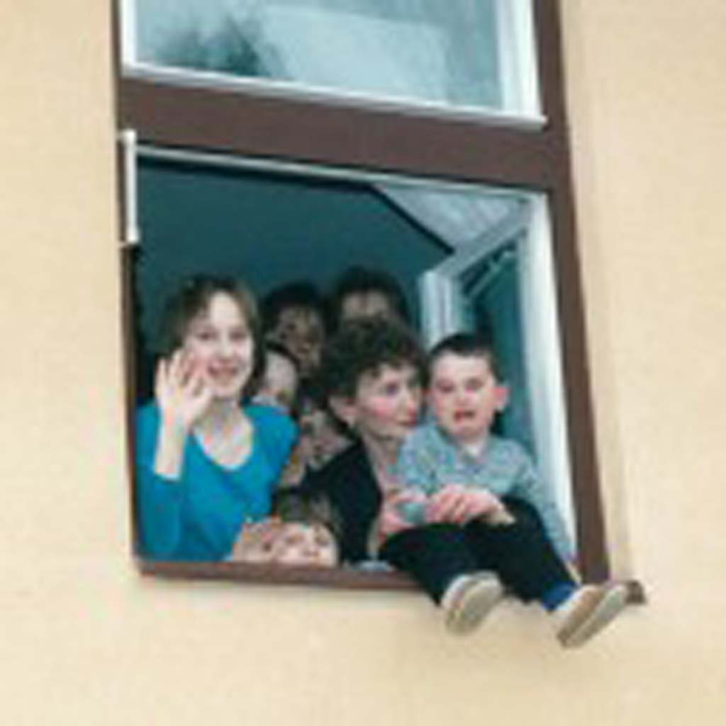 Our family traveled to Slovakia in May 2002 after researching my husband's family tree and found many cousins still in the country. His maternal and paternal grandparents had emigrated from eastern Slovakia to the United States in the early 1900s but left behind many relatives. My husband took this photo of the  eight cousins as they gathered in a window to say goodbye to us. Their parents had hosted a luncheon in their modest home (no indoor plumbing) on their small farm. They had laid out quite a feast but only the father and oldest daughter ate with us. The rest of the women served us, and the children in this photo had lined up against the wall to watch us eat and converse. I guess they considered the strange relatives from America entertaining. [Photo by Jerry Ondash]
