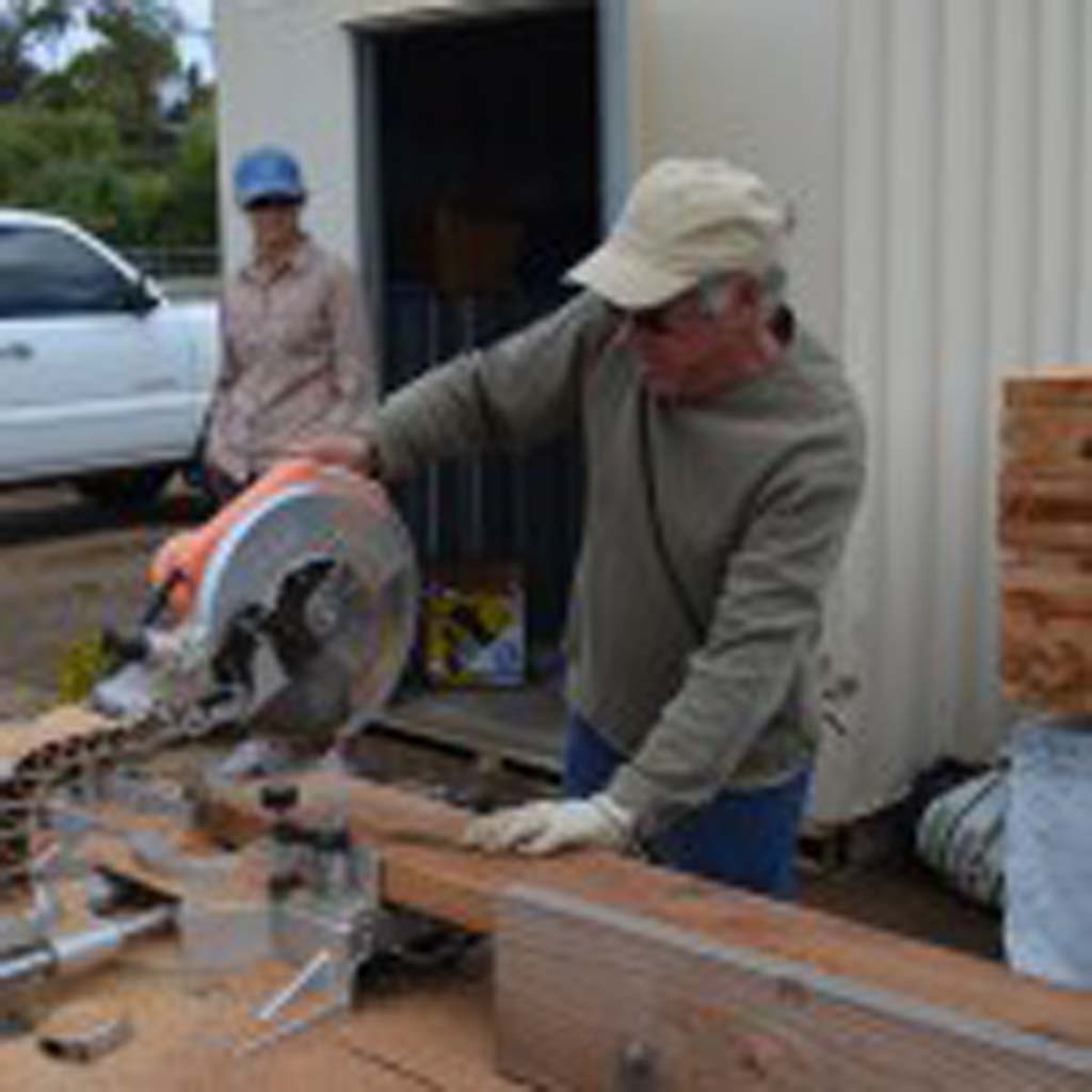 Mike Murphy takes a buzz saw to wood for a planter box for the Encinitas Community Garden.