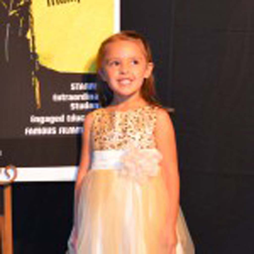5-year-old Krysten Thompson, who appeared in the short film The Gentleman's Bartender, poses on the red carpet.
