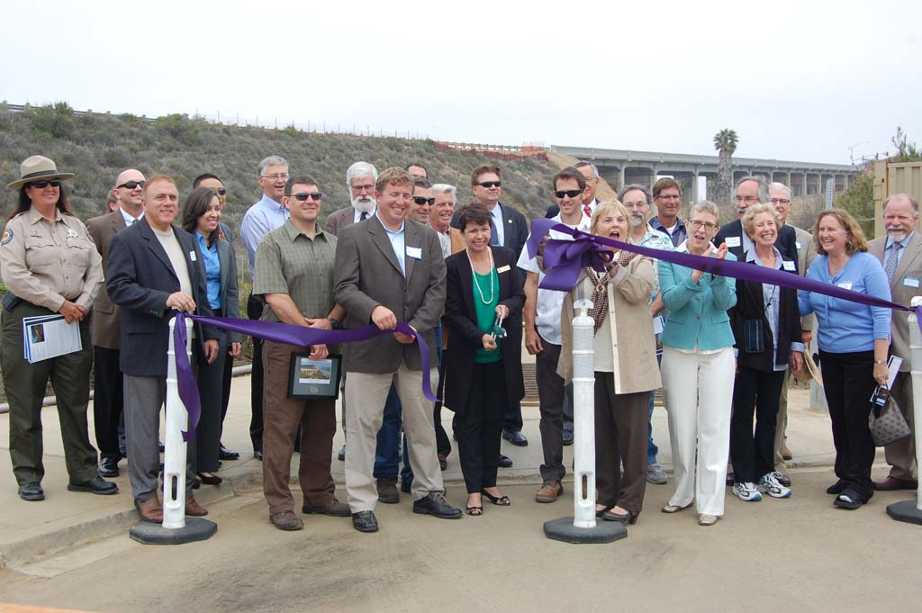 Current and former City Council and staff members, contractors and representatives from the California Department of Transportation and Federal Highway Administration take part in the ribbon cutting. Photo by Bianca Kaplanek