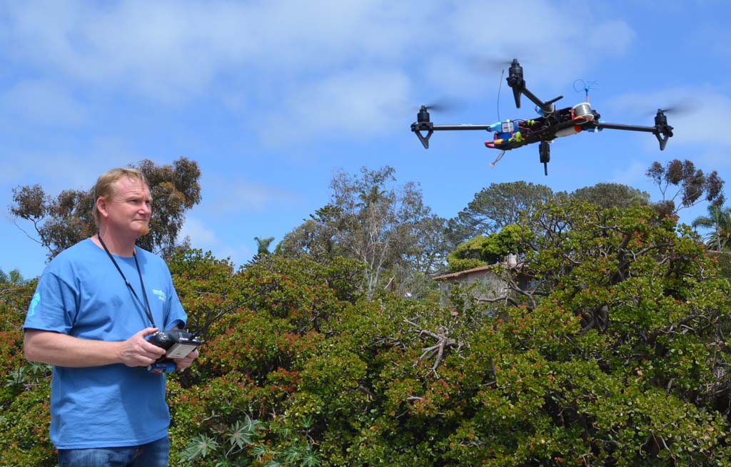 Treggon Owens' unmanned aerial vehicle rises into the sky in Encinitas. Owens and others see big potential for commercial drones. They must overcome uncertain regulations and privacy concerns. Photo by Jared Whitlock