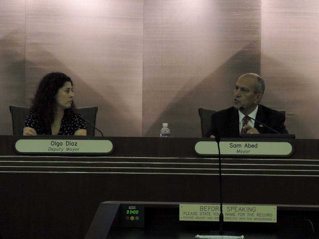 Escondido Deputy Mayor Olga Diaz, left, and Mayor Sam Abed discuss what power the City Council could have. Photo by Rachel Stine