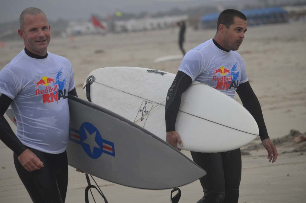 U.S. Navy AWR1 Nick Barringer, left, emerges from a heat with U.S. Military surf team member. Photo by Tony Cagala