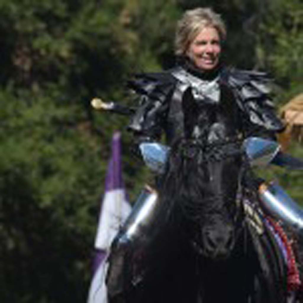 "Sandy Draper on Indiana, or ""Sir Indy"" for the Renaissance Faire on May 3 in Escondido's Felicita Park. Indiana is a 20-year-old approved Friesian Horse. Photo by Tony Cagala"