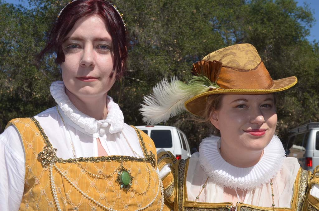 Faye Card, left, and Emily Bennion are members of the Queen's Court. Photo by Tony Cagala